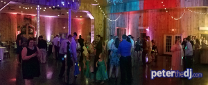 A panoramic shot to show the white and coral uplighting (contrasting with the changing colors of the dance floor lights)